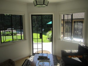 Drop Down Retractable Screen Windows installed in Guest Room
