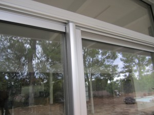 Encino installation of Clear Anodized Retractable Screen Door for a patio sliding screen door