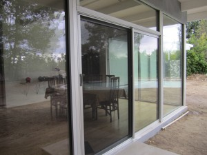 Clear Anodized Retractable Screen Door for a patio sliding screen door