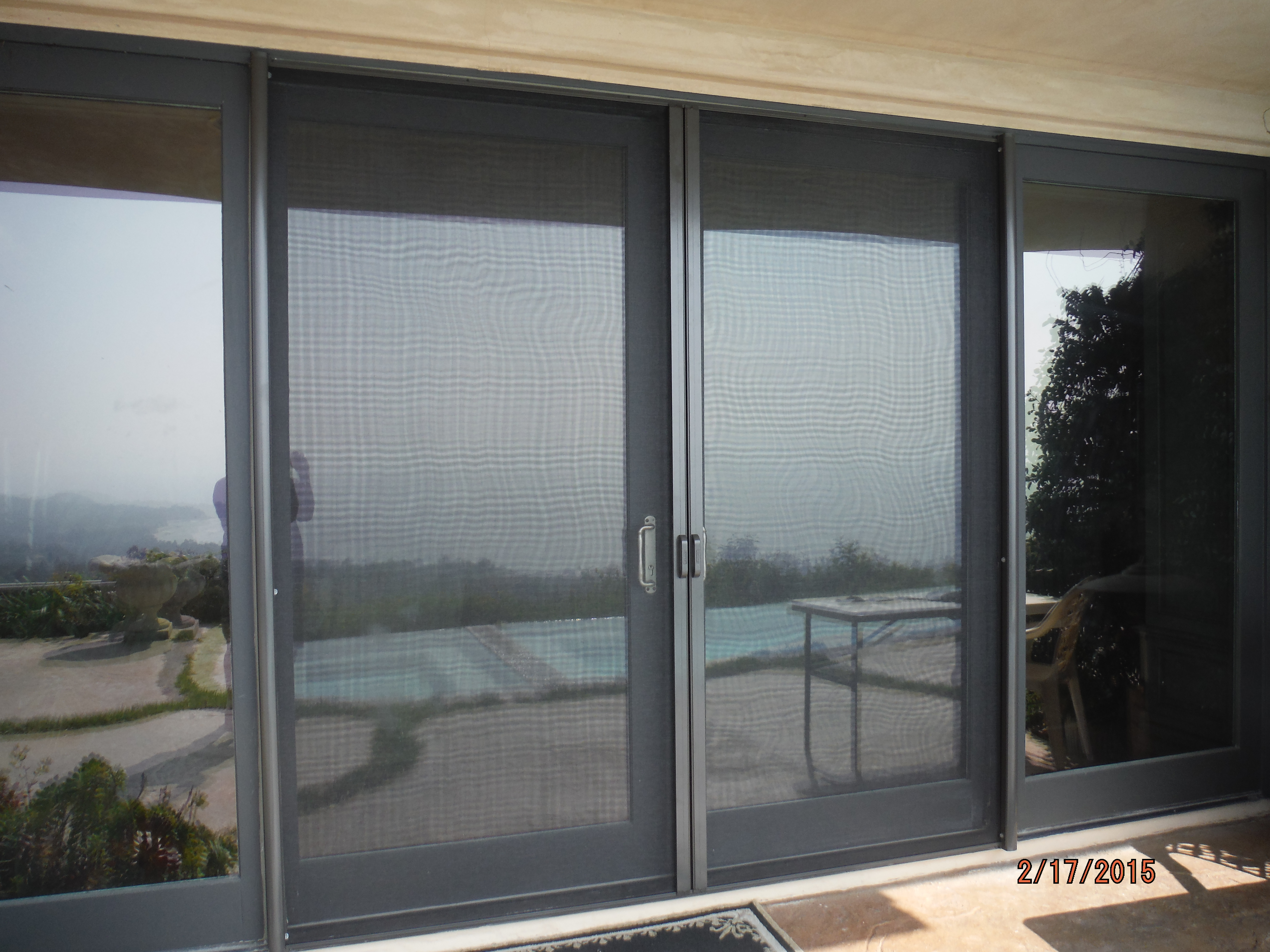Double Set Disappearing Screen Doors installed in Malibu