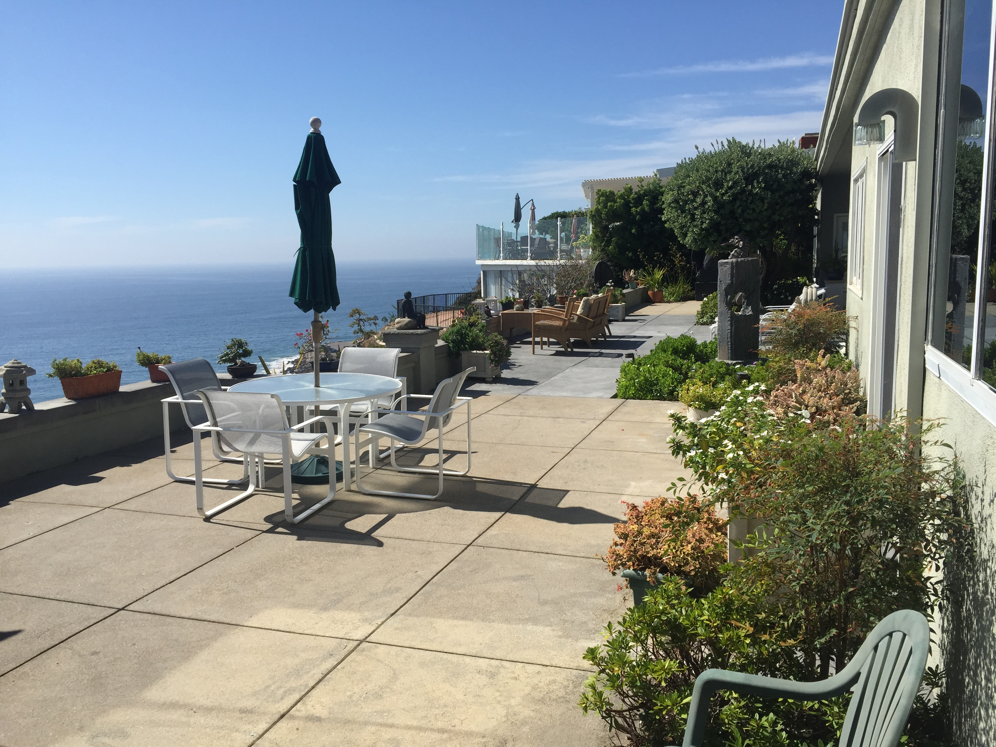 Mobile Screen Service and Repair in Malibu, CA. Custom Made Patio Sliding Doors installed on exterior Malibu